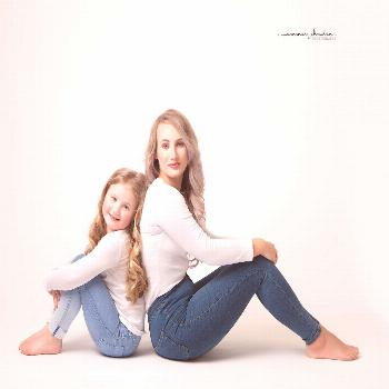 Mother and daughter  Mother and daughter studio portrait.
