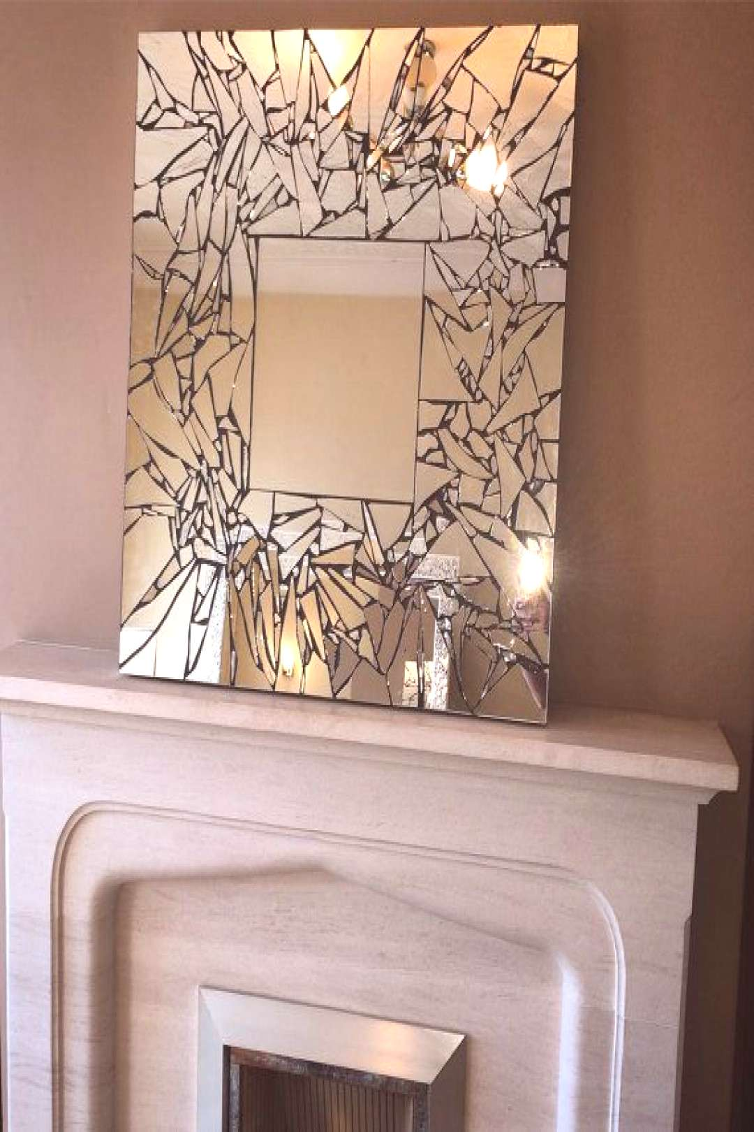 Handmade mosaic mirror- interesting use of mirror and black grout. Need to use an adhesive that doe
